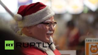 Japan: Dozens queue to get their Christmas fried chicken from KFC in Tokyo