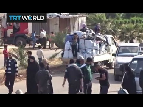 The War in Syria: Rebel fighters and their families evacuate Homs