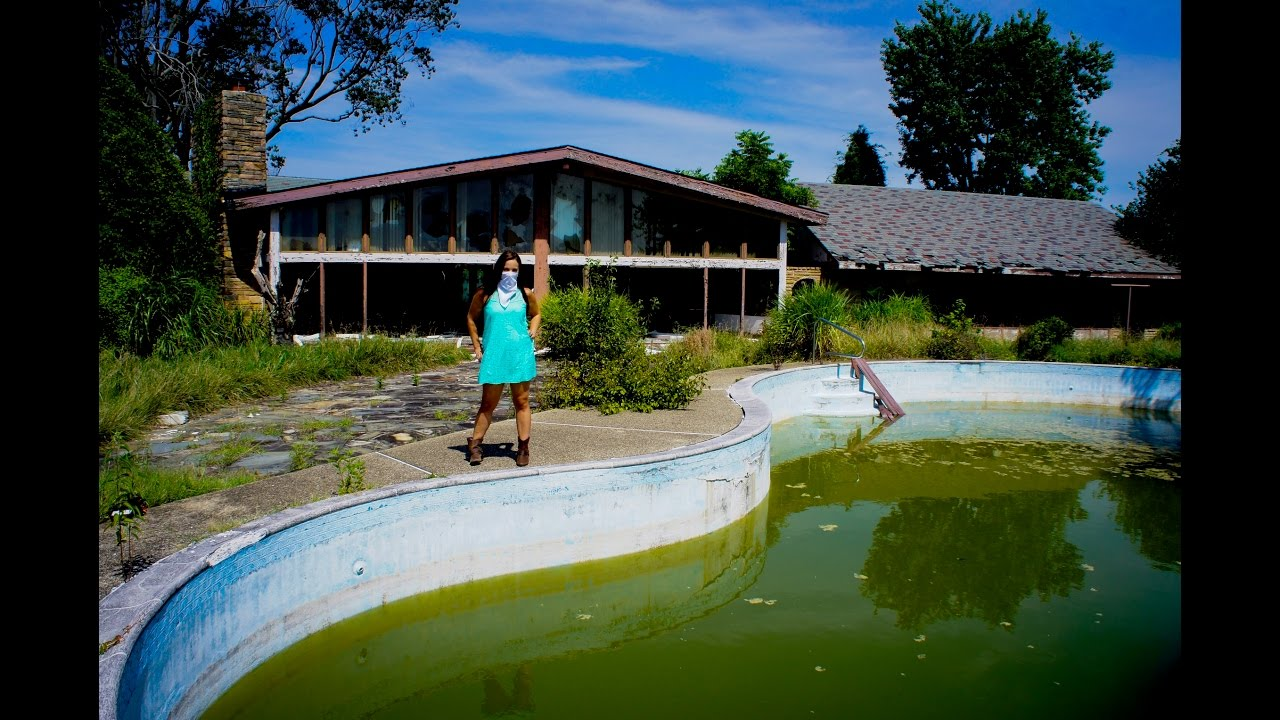 abandoned mansion indoor pool and outdoor pool with green