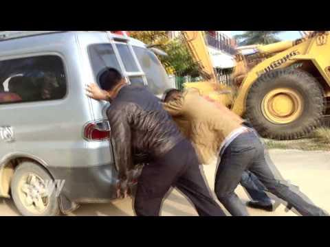 RWV:  Pushing dead car in Vang Vieng, Laos during my trip 2014