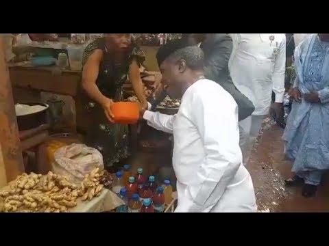 Market Woman Tries To Pour Garri On VP Osinbajo's Hand At Ikenne Market