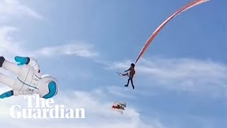 Child lifted metres into the air by giant kite at Taiwan festival