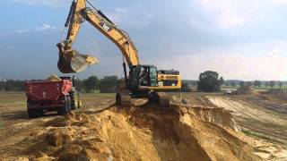 CAT 345D L loading tractor with dump trailer