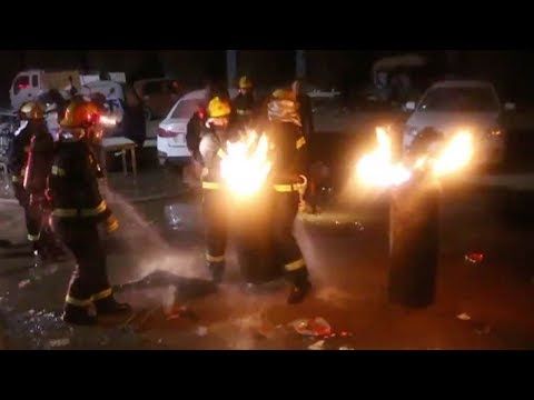 Firemen risk lives to put out blazing gas tanks