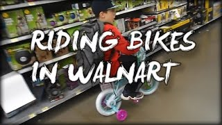 RIDING BIKES IN WALMART!!! (fooling around in walmart)