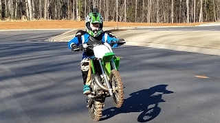 10 year old does top speed on a dirt bike. Kawasaki kx65 new!