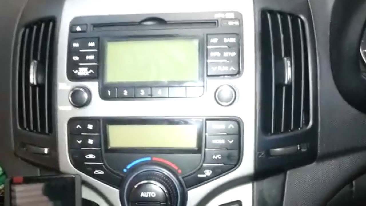 remove the factory radio from a Hyundai i30 - YouTube