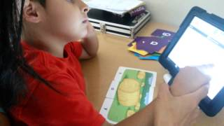 Autistic 8 year old boy using AAC ipad