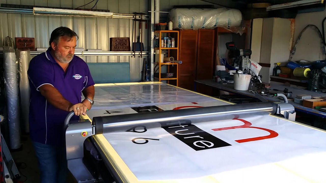 Andrew From Ams Signs Applying Laminated Vinyl Sign Using