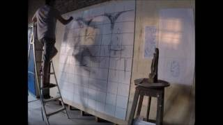 Pintando a cena do Frei Agostinho de Jesus.