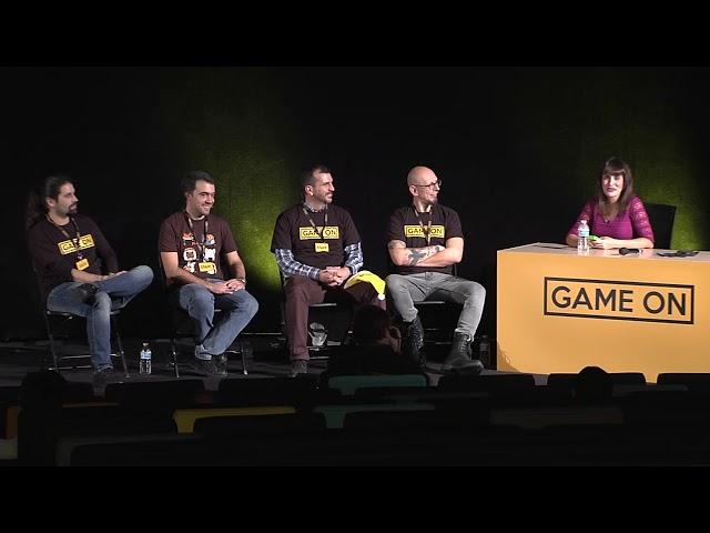 Mesa redonda con traductores de juegos de mesa en Game On 2018