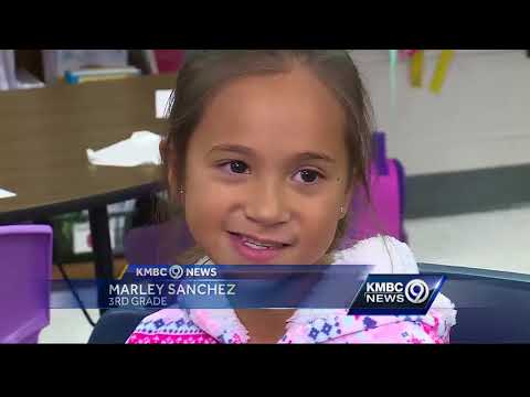 Kansas City soldier surprises family at school