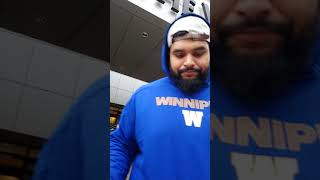 Sukh Chungh signs some 2018 Winnipeg Blue Bombers cards for DAGR Sportscards and Collectibles