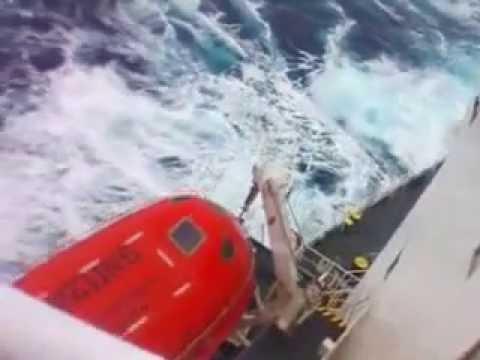 MV Bulk carrier sailing in heavy seas