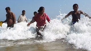 people-are-enjoying-sea-bath-at-puri-sea-beach-india-in-4k-ultra-hd