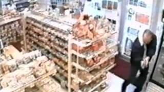 Guy runs into armed cop while trying to rob a store.