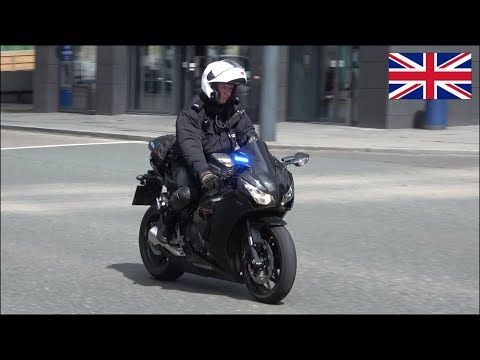 Unmarked Merseyside Police motorcycle performing a traffic stop in Liverpool
