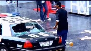 Man smashes out LAPD Car windows in Hollywood