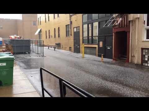 Pea-sized hail falls in downtown Flint