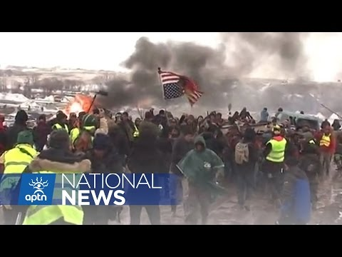 Sheriffs Department Backed by National Guard, State Police Move in on NoDAPL Camp | APTN News