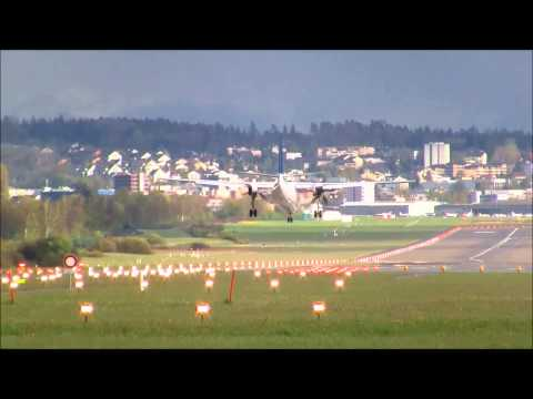 Denim Air Fokker-50 landing runway 14 at ZRH