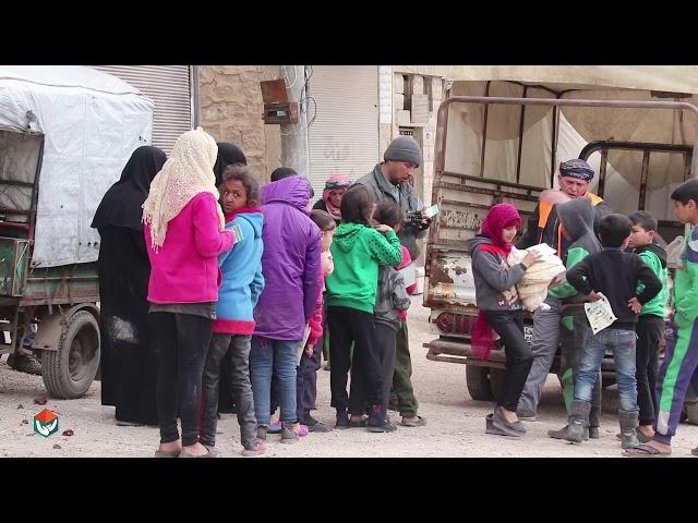 توزيع الخبز على اهلنا النازحين في مدينة الباب