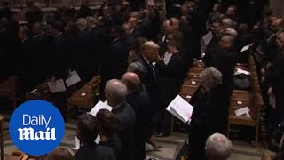 Trumps leave Bush's funeral before the casket exits the cathedral