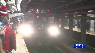 Subway riders take a `trip to the past` on vintage train