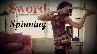 Sword belly dancing: spinning