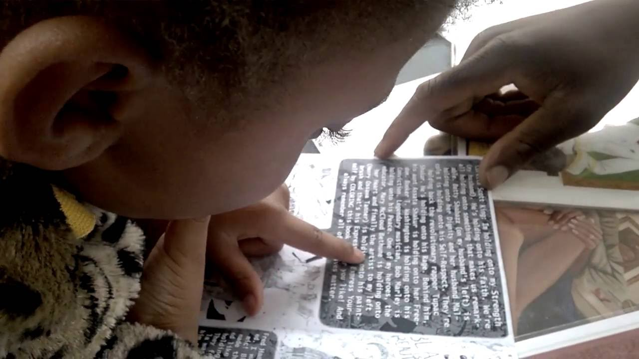Black Lives Matter Coloring Book Author And Illustrator D Marque Hall Reads With Young Girl