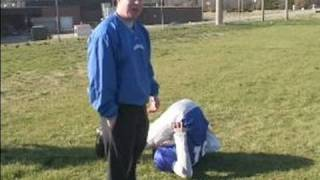 Football Practice Drills & Tips : Lower Back Stretches for Football
