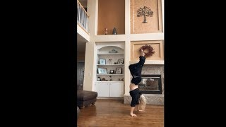 Woman Smoothly Takes Off Her Pants For A Handstand Challenge