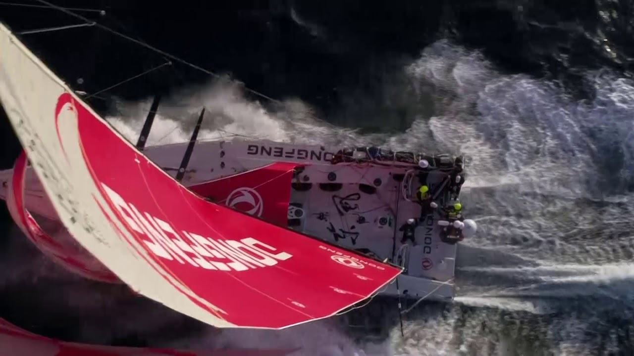 Epic drone shots of Dongfeng sailing fast on starboard, including slomo with bird.