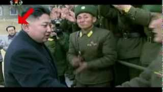 Repeat youtube video Kim Jong-un's executed uncle airbrushed from film