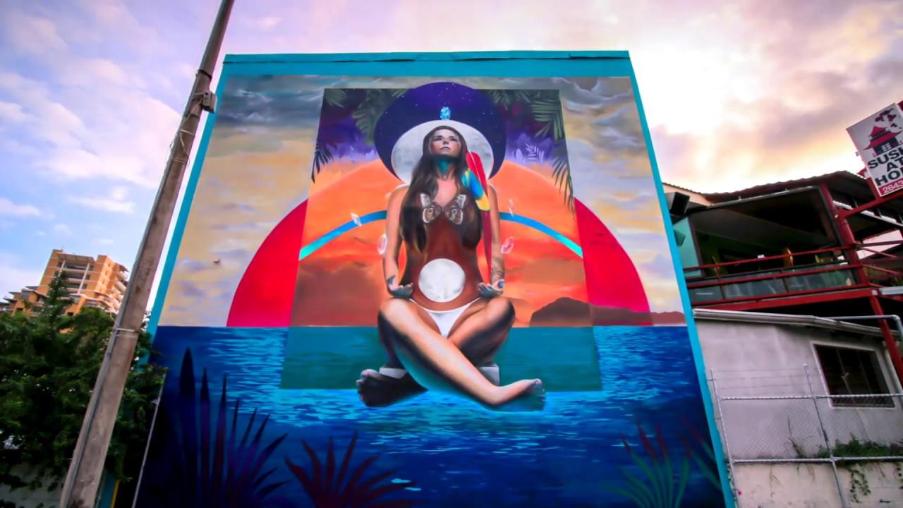 Painting Mujer Sagrada mural in Costa Rica - Diego Roa
