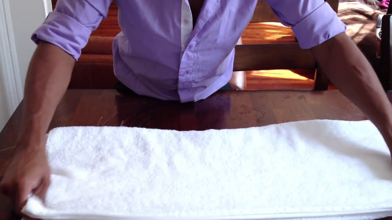 How to fold a towel like they do at hotels - YouTube