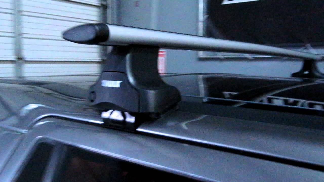 land rover lr2 with thule rapid traverse aeroblade roof rack by rack outfitters