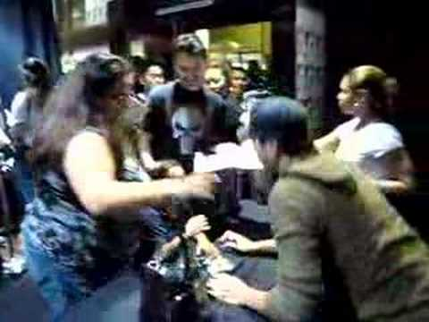 Enrique signs an autograph for a young fan