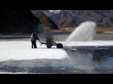 Cutting ice from the Miyun Reservoar, N Beijing, China