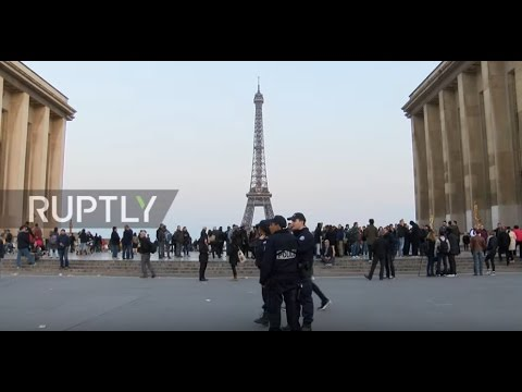 France: Paris residents and police pay tribute to victims of Champs Elysees shooting