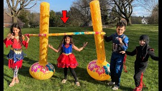 Superheroes Play Inflatable Limbo game challenge -  family fun game