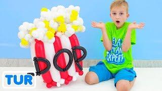 Vlad ve Nikita balondan oyuncaklar yaparak anneleriyle eğleniyor