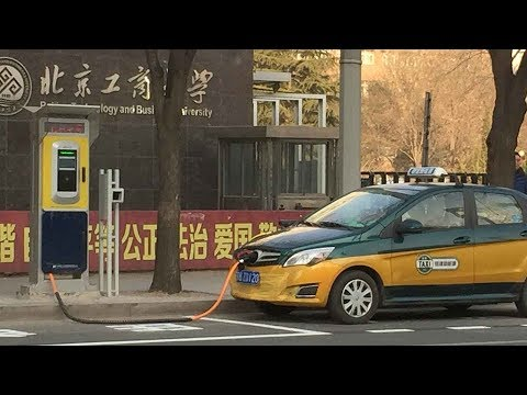 Beijing's electric taxis are cleaner, but battery woes leave drivers flat