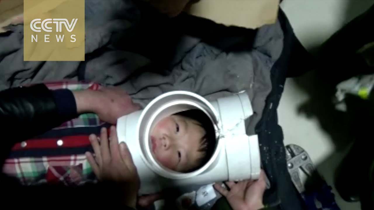 Naughty boy gets head stuck in plastic water pipe - YouTube