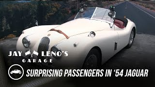One of Jay Leno's Garage's most viewed videos: Jay Leno Surprises Passengers in His '54 Jaguar - Jay Leno's Garage