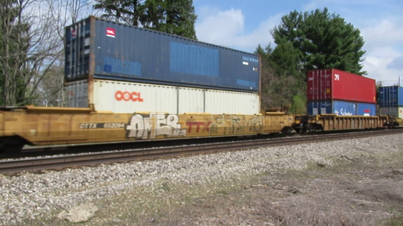 CN 5660, 2183 moving a Westbound intermodal container train past Vicksburg,  MI