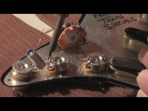 How to wire your stratocaster, test pots, select capacitor and make tone control wiring decisions.