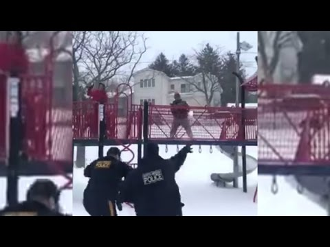 Thumbnail: Watch These Officers Let Loose And Have A Snowball Fight With Kids During Storm