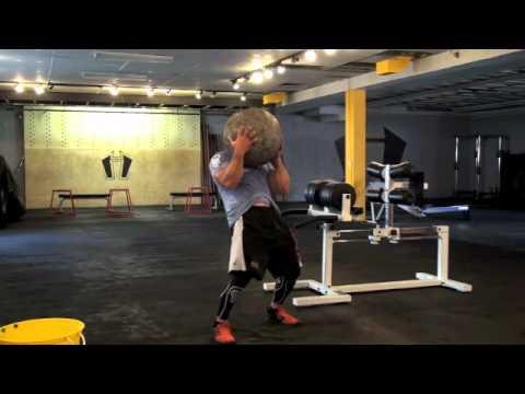 Rob O from Hybrid Athletics doing Atlas Stone Squats