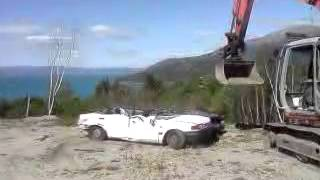 Crushing A Mazda 323 With An Excavator :)